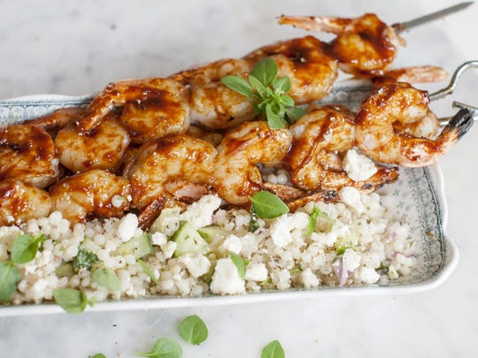 Serve maple bourbon barbecue grilled shrimp with couscous.