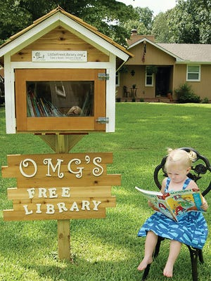 Maddy Grace Naber enjoys reading and visiting her new Little Free Library in her front yard.