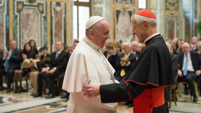CORRECTS THE CREATION DATE TO APRIL 17, 2015, NOT OCT. 20, 2010 - FILE - In this April 17, 2015, file photo, Pope Francis, left, talks with Papal Foundation Chairman Cardinal Donald Wuerl, Archbishop of Washington, D.C., during a meeting with members of the Papal Foundation at the Vatican. On Tuesday, Aug. 14, 2018, a Pennsylvania grand jury accused Cardinal Wuerl of helping to protect abusive priests when he was Pittsburgh's bishop. (L'Osservatore Romano/Pool Photo via AP)