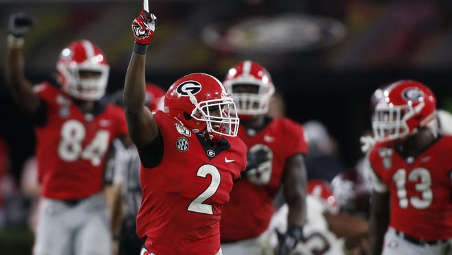 Georgia defensive back Richard LeCounte celebrates after a stop against Texas A&M in Athens, Ga., on Nov. 23, 2019.