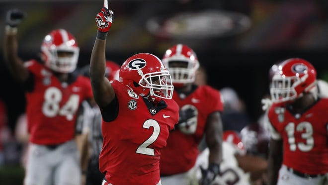 FILE - In this Nov. 23, 2019, file photo, Georgia defensive back Richard LeCounte (2) celebrates after a stop against Texas A&M on Nov. 23, 2019 in Athens. LeCounte, a Liberty County High School graduate, was selected to The Associated Press All-America first team on Tuesday.