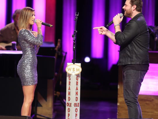 Cassadee Pope and Chris Young perform at the Grand