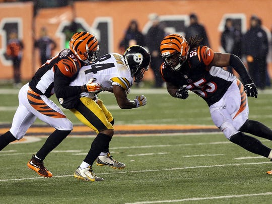 Jan 9, 2016; Cincinnati, OH, USA; Cincinnati Bengals outside linebacker Vontaze Burfict (55) hits Pittsburgh Steelers wide receiver Antonio Brown (84) during the fourth quarter in the AFC Wild Card playoff football game at Paul Brown Stadium. Burfict was called for a personal foul on the play. Mandatory Credit: Aaron Doster-USA TODAY Sports