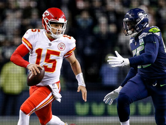 Chiefs quarterback Patrick Mahomes (15) scrambles against Seahawks defensive end Frank Clark during a Dec. 23, 2018, game.