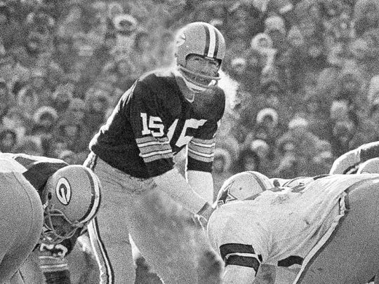 In this Dec. 31, 1967, file photo, Green Bay Packers quarterback Bart Starr calls signals in bitter cold as he led the Packers to a win over the Dallas Cowboys in Green Bay, Wisc. Fifty years later, players from the Packers and Cowboys still shiver from memories of the bitter cold of a game that would become known as the Ice Bowl.
