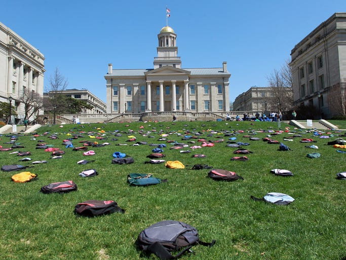 Backpacks cover the Pentacrest lawn on Tuesday, April 22, 2014. The 1,100 backpacks were arranged by the Active Minds organization; each backpack represents one college student who dies by suicide each year. The traveling exhibit has made stops at over 90 campuses.