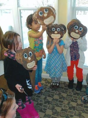 St. John Lutheran School 4K students act like monkeys to entertain residents at Evergreen Park Assisted Living in Kronenwetter.