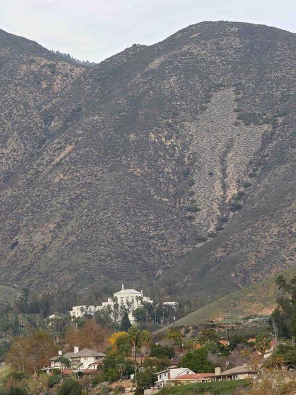 The long-closed Arrowhead Springs resort stands below