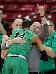 Oshkosh North coach Brad Weber hugs Tyrese Haliburton at the end of the WIAA Division 1 championship game last spring.