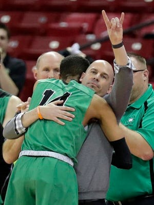 Oshkosh North head coach Brad Weber hughs Tyrese Haliburton (14) at the end of the Division 1 championship game at the WIAA 2018 state boys basketball tournament at the Kohl Center on Saturday, March 17, 2018 in Madison, Wis. Oshkosh North won, 61-44.