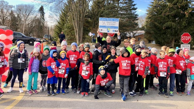An estimated 350 students, families, teachers and business owners took part in the Eastover Pancake Dash, which raised some $7,500 to help renovate the Eastover Elementary School playground.