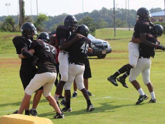Kenwood players work on drills during Monday's practice.