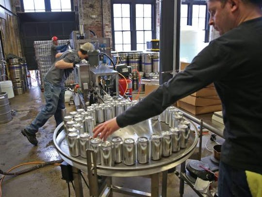 Indiana City Brewing Co. brewer Nick Shadle (right)