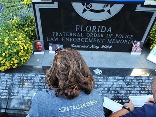 Officer Joe Heddy's daughter, Joy Laub, traces her