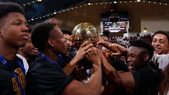 Mount Vernon player hoist the gold ball after their