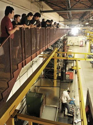 Students from several high schools and a middle school view the assembly area as they tour Haas Automation in Oxnard.