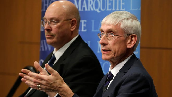 Lowell Holtz (left) and Tony Evers, candidates for state superintendent of public instruction, discuss educational issues Tuesday during a debate at  Marquette University Law School.