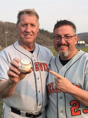 Denny Miles, left, with assistant coach John Anderson after Friday's 14-2 win over Cuba-Rushford. It was Miles' 706th career victory.