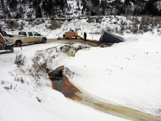 This Dec. 10, 2016 photo provided by the North Dakota Department of Health shows a cleanup crew at the site of oil spill from the Belle Fourche Pipeline that was discovered Dec. 5 in Ash Coulee Creek, a tributary of the Little Missouri River, near Belfield, N.D. The discovery of the pipeline spill in western North Dakota has drawn heightened attention because of the battle over the Dakota Access oil pipeline being built across the state.