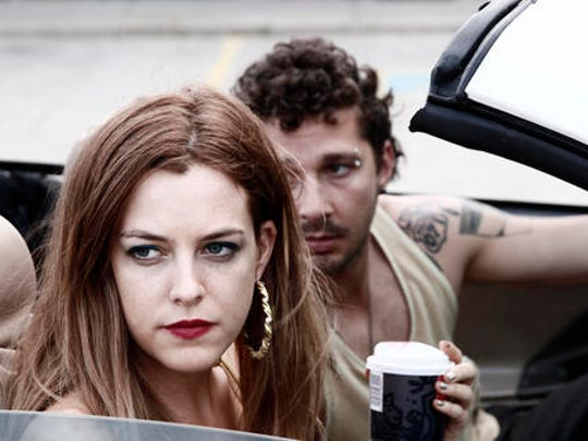 "This image released by A24 Films shows Riley Keough and Shia LaBeouf in a scene from, ""American Honey."""