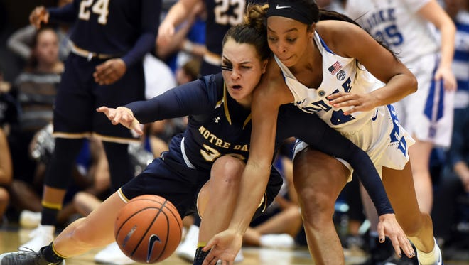 Duke Blue Devils guard Lexie Brown (3) tips the ball away from Notre Dame Fighting Irish forward Kathryn Westbeld (33) during the second half at Cameron Indoor Stadium. Notre Dame won 72-54.