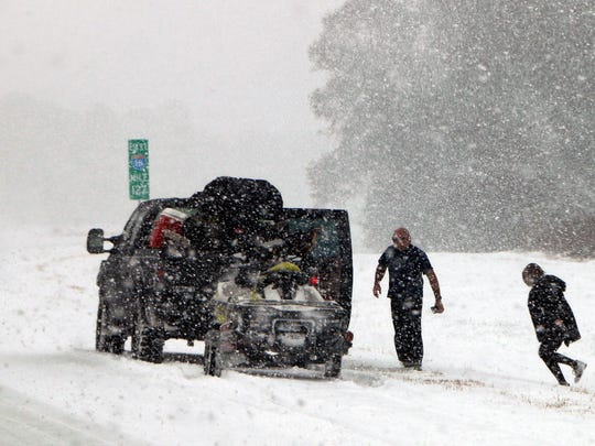 A vehicle is stopped on Interstate 26, near Savannah, Ga., on Jan. 3, 2018.