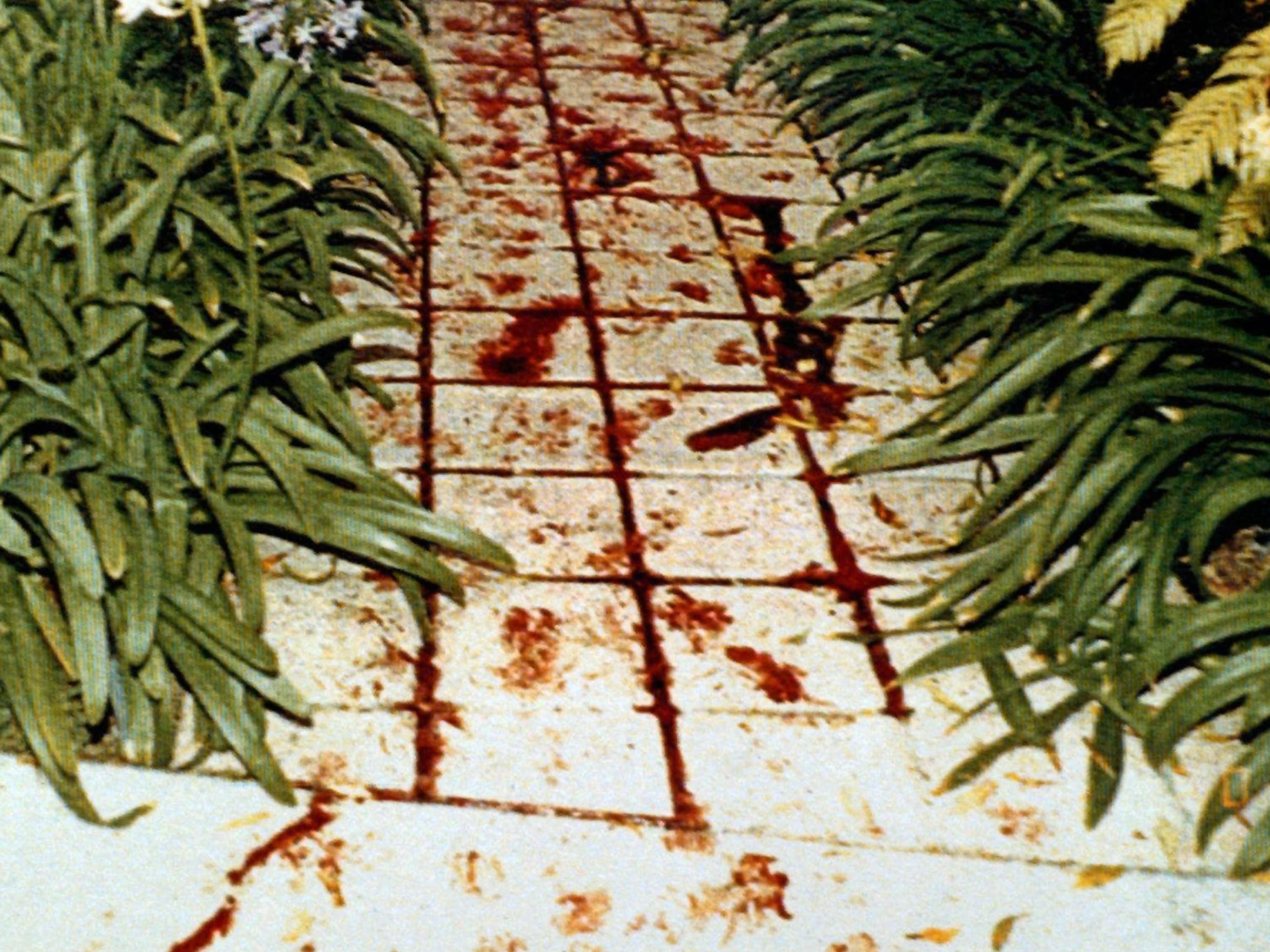 A photo from the Los Angeles Police Department shows blood and footprints found at the scene of Nicole Brown Simpson and Ronald Goldman's murder.