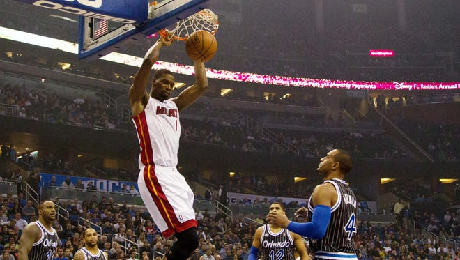 Miami Heat center Chris Bosh dunks the ball during the first quarter of the game against the Orlando Magic at the Amway Center.