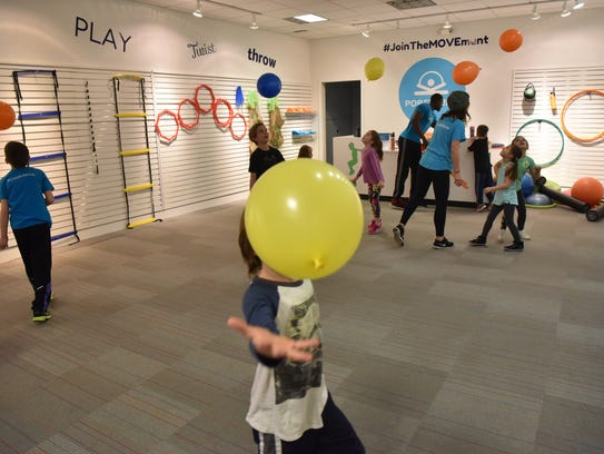Children play with balloons at PopFit Kids in Paramus
