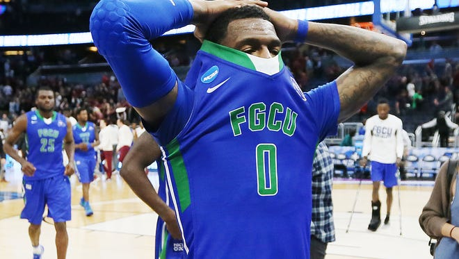 FGCU's Brandon Goodwin and teammates leave the court after loosing to FSU on Thursday, March 16, 2017 in the NCAA Men's Division I Basketball Tournament at the Amway Center in Orlando. FSU beat FGCU 86-80.