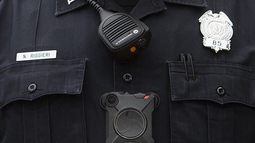 A Worcester police officer wears a body camera during a pilot program last year.