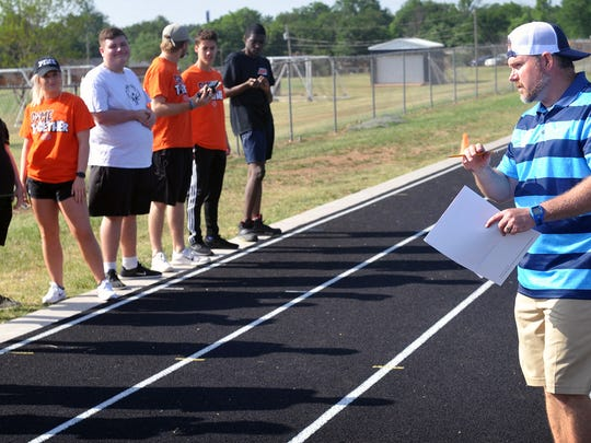Mike Strickland, area director for Special Olympics Texas, explains the rules to athletes and volunteers competing in a track event at the Special Olympics Unified Sports Day Thursday at Rider High School.