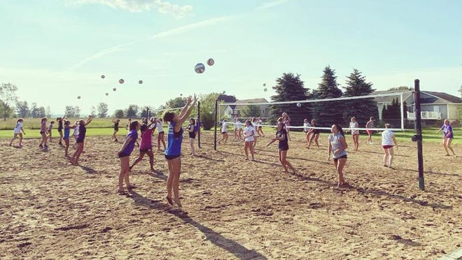 Zeeland East volleyball players work on drills during a summer workout last week.