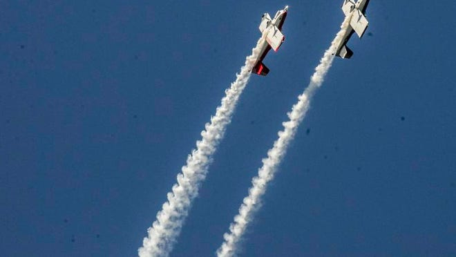 Team AeroDynamix takes to the sky during the final day of the 2014 Greater Binghamton Airshow on Saturday.