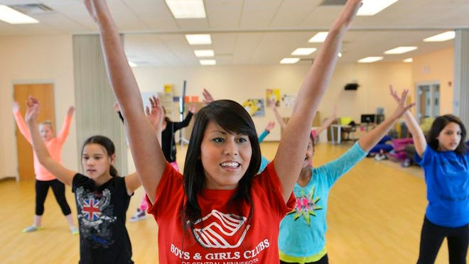 Youth Dance Artist and Mentor Jacqueline Kling (center) leads a dance skill development class for 9- to 13-year-olds Monday afternoon at the Eastside Boys & Girls Club in St. Cloud.