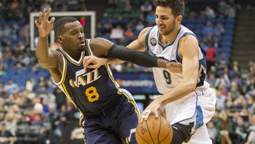 Minnesota Timberwolves guard Ricky Rubio (9) drives to the basket against Utah Jazz guard Shelvin Mack (8) in the first half Saturday at Target Center in Minneapolis.