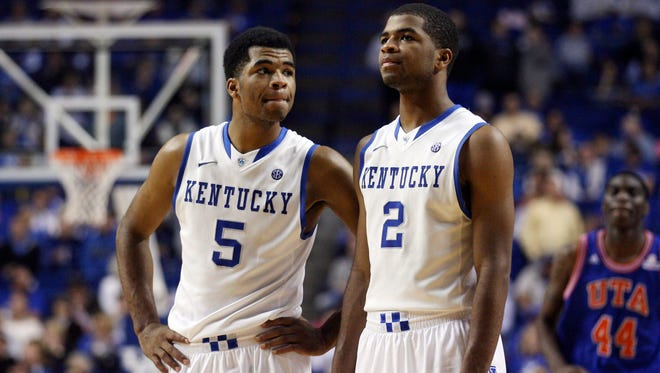 Nov 19, 2013; Lexington, KY, USA; Kentucky Wildcats guard Andrew Harrison (5) and guard Aaron Harrison (2) react during the game against the Texas-Arlington Mavericks in the second half at Rupp Arena. Kentucky defeated Texas-Arlington 105-76. Mandatory Credit: Mark Zerof-USA TODAY Sports