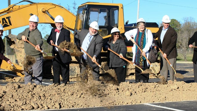from left to right: MORA Manager of Physician Services Lee Waldrop, MORA Hospital Development Coordinator Sonny Soileau, MORA Advisory Committee Chairman Phillip Grady, MORA CEO Kevin Stump, MORA Family Care Specialist Vicki Shoemake, MORA Chairman of the Board Dr. Shirley Schlessinger, Jeff Peoples of Peoples Construction and Michael Boerner of Wier Boerner Allin Architects participate in the ceremonial dirt throw at the groundbreaking for the new clinical addition that is projected to open in the fall of 2016.