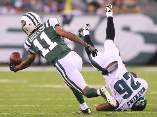 New York Jets wide receiver Robby Anderson attempts to catch a pass while being defended by Philadelphia Eagles defensive back Jaylen Watkins during the first half at MetLife Stadium in East Rutherford, N.J.