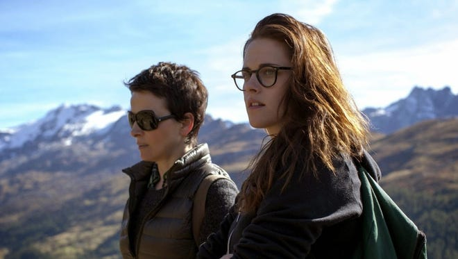 """Maria (Juliette Binoche, left) and her assistant (Kristen Stewart) ponder the future as they hike the Alps in """"Clouds of Sils Maria."""""""