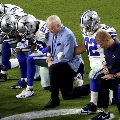 The Cowboys, led by owner Jerry Jones, center, take