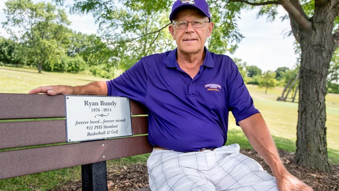 Keith Bundy, 72, sits on the bench installed in honor of his son, Ryan, on No. 7 at Kellogg Golf Course in Peoria. Bundy hit a hole-in-one on No. 7 on June 14. Ryan died unexpectedly six years ago at the age of 38.