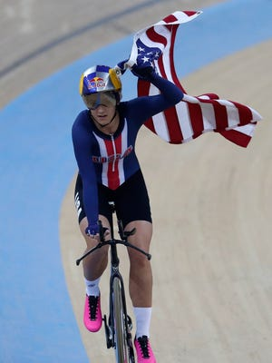Chloe Dygert of the United States celebrates after winning the women's individual pursuit final at the World Track Cycling championships in Hong Kong, Saturday, April 15, 2017. (AP Photo/Vincent Yu)