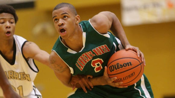 Lawrence North's Pat Baccon drives past Warren Central players, Jan. 11, 2014.