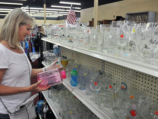 Elaine Beck shops in the glassware section of the