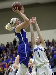 Senior center Heather Pearson (left) averages a team-high 16.7 points and 9.0 rebounds for Amherst heading into a WIAA Division 3 state semifinal Thursday with St. Thomas More at the Resch Center in Ashwaubenon.