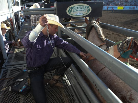 R.C. Landingham prepares to compete Thursday during the Redding Rodeo.