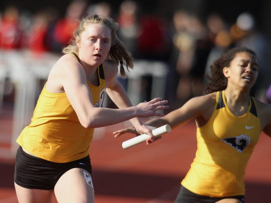 Southeast Polk's Grace Larkins takes the baton from