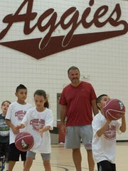 Chris Jans, NMSU head basketball coach, cheers on campers