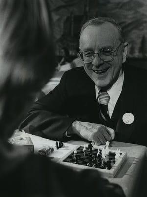 Frank P. Zeidler, Socialist Party USA candidate for president, joins Les V. Iverson, 25, for a friendly game of chess at his election party Nov. 2, 1976, at Turner Hall.